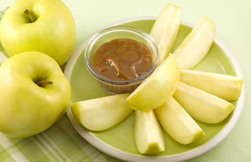 Yellow Apple Slices with Caramel Dip stock photos