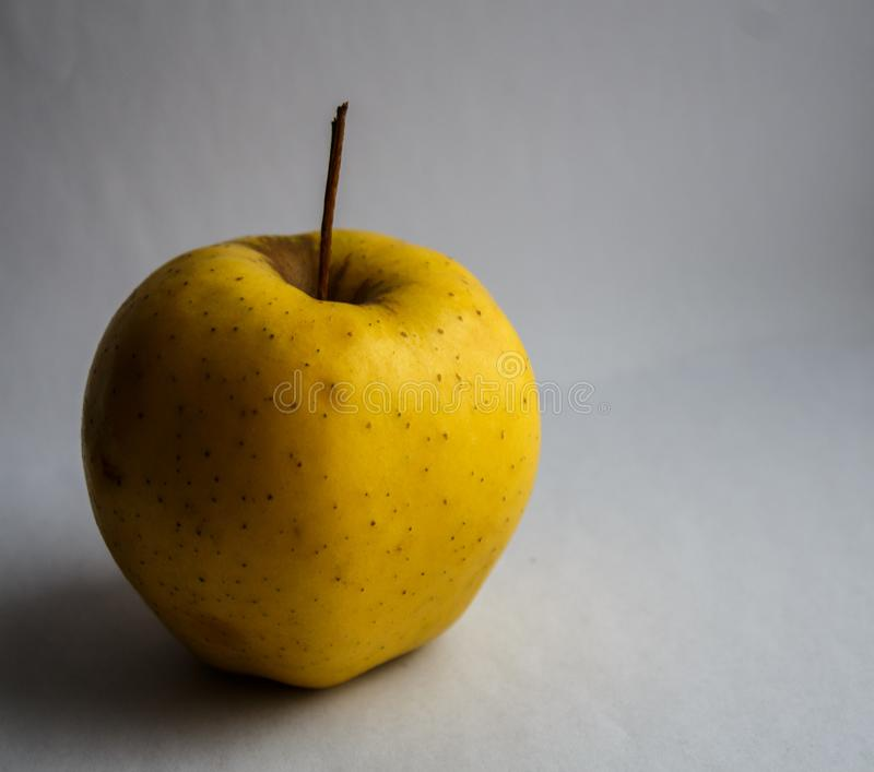 A yellow apple royalty free stock photo