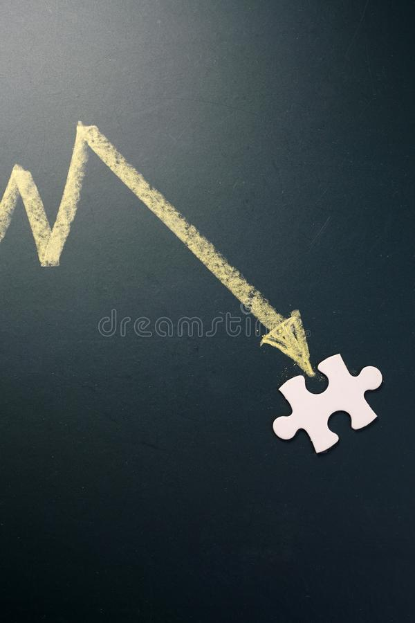 Graph drawing pointing down to jigsae puzzle royalty free stock image