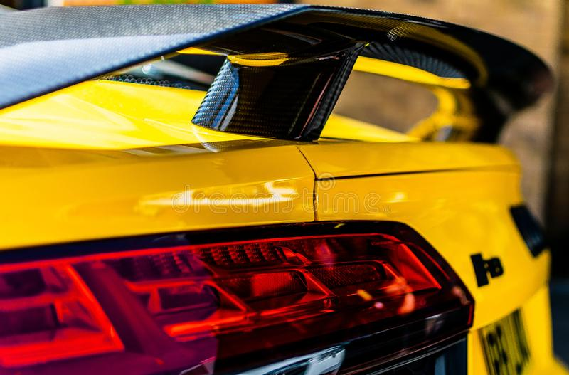 Yellow Audi car black spoiler up close beautiful vivid colour amazing. Great car picture photography stock image