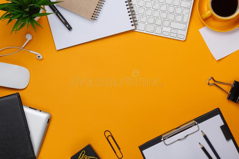 Yellow background mess on your desktop keyboard mouse cup of coffee business royalty free stock photo