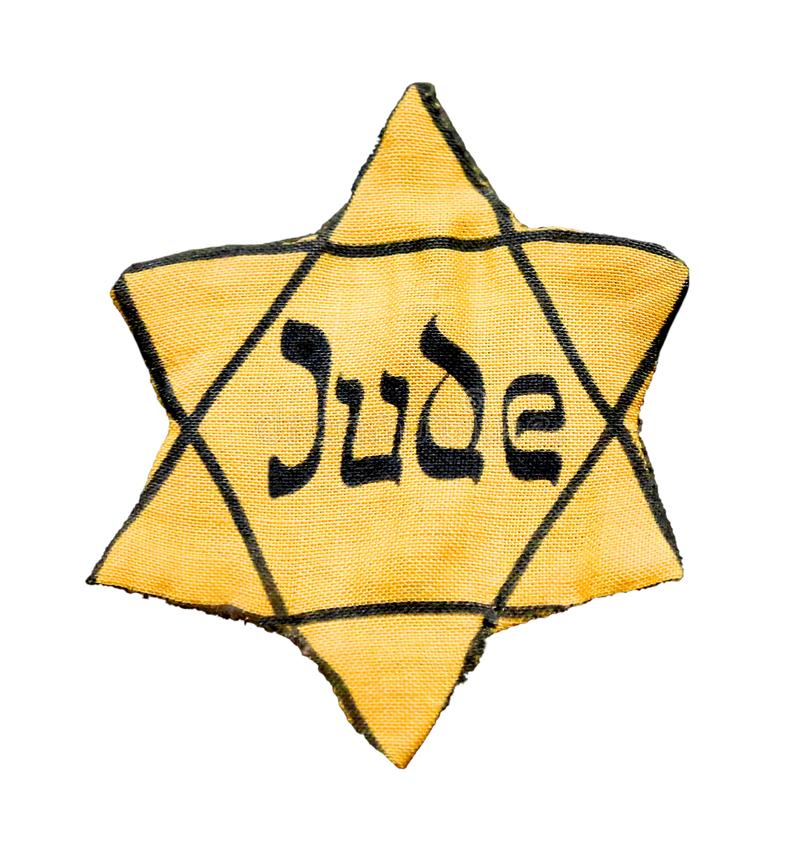 Yellow badge of Star of David is is a symbol of modern Jewish i stock photos