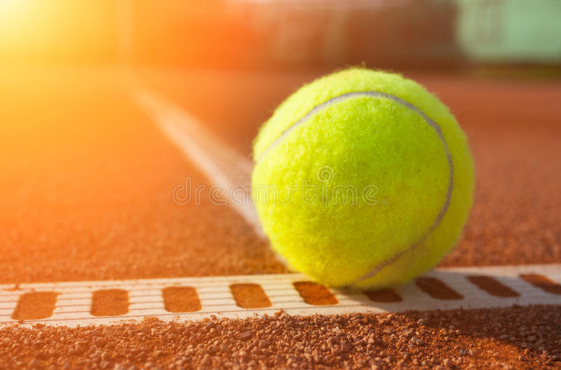 Yellow ball on the court ground. And a morning light royalty free stock photo