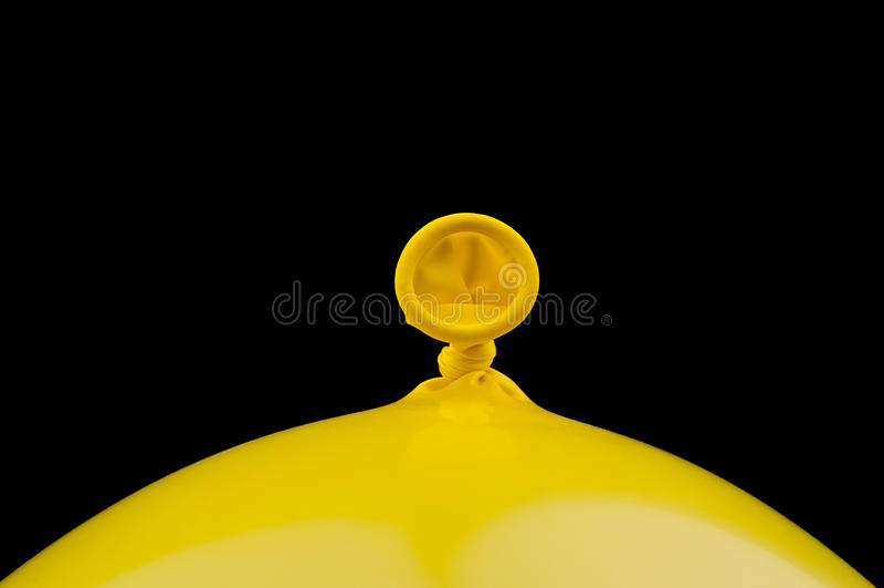 A yellow ballon on black royalty free stock image