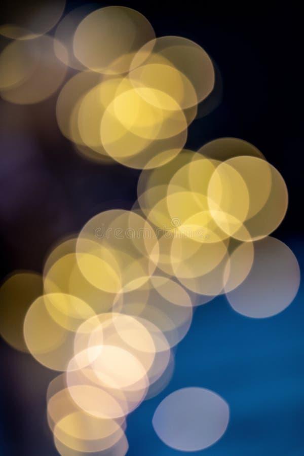 Yellow balls overlaid on blue and purple background. Bokeh. Christmas theme stock photos