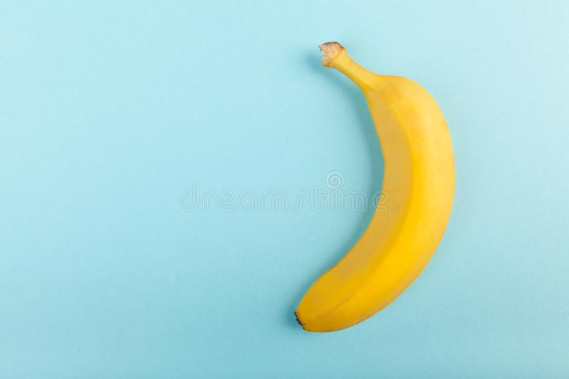 Yellow banana on pastel blue background. Top view stock photo