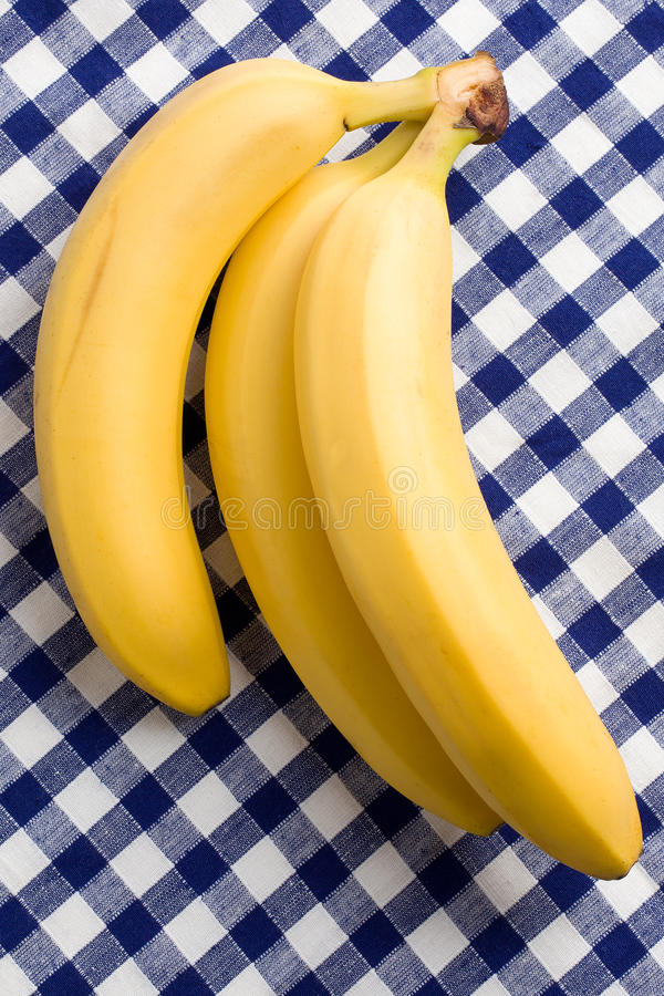 Download Yellow Bananas On Checkered Tablecloth Stock Image - Image of jungle, freshness: 17020531