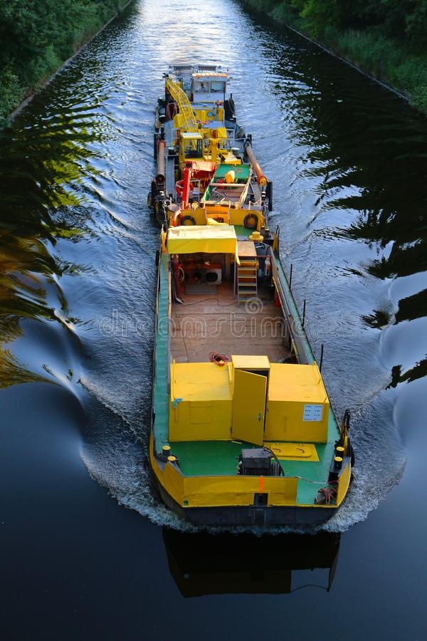 Yellow barge during transport. River transport. royalty free stock image