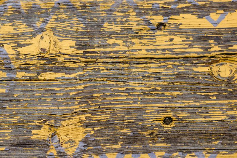 Yellow Barn Wooden Wall Planking Horizontal Texture. Old Wood Slats Rustic Shabby Empty Background. Paint Peeled Brown Weathered I. Yellow Barn Wooden Wall royalty free stock photography