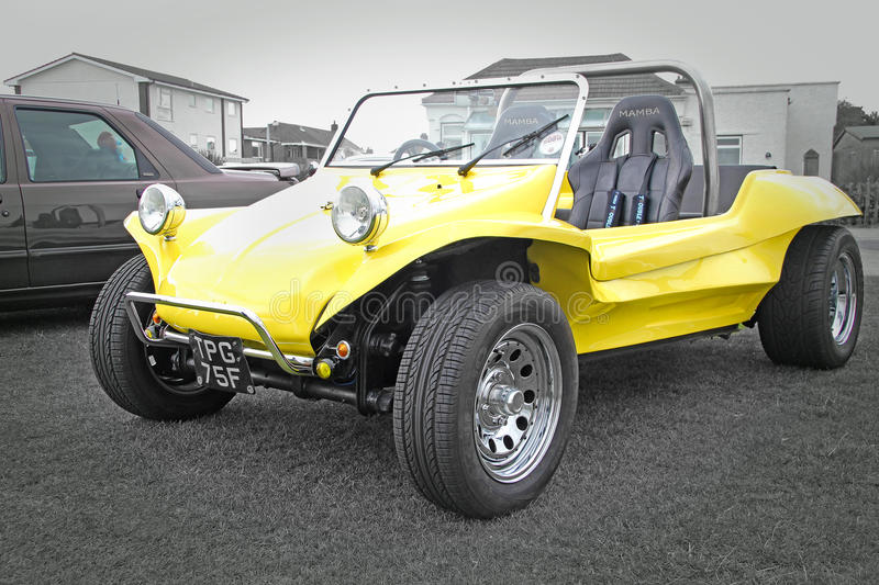 Yellow beach buggy. Photo of a bright yellow beach buggy being displayed at the vintage car show in whitstable kent on 17th august 2014.photo ideal for outdoor stock image