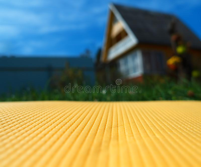 Yellow bedstone texture near country side house background. Horizontal orientation vivid vibrant bright color spacedrone808 rich composition design concept royalty free stock images