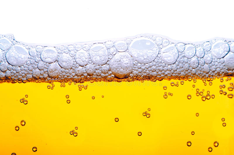 Yellow beer with foam stock photography
