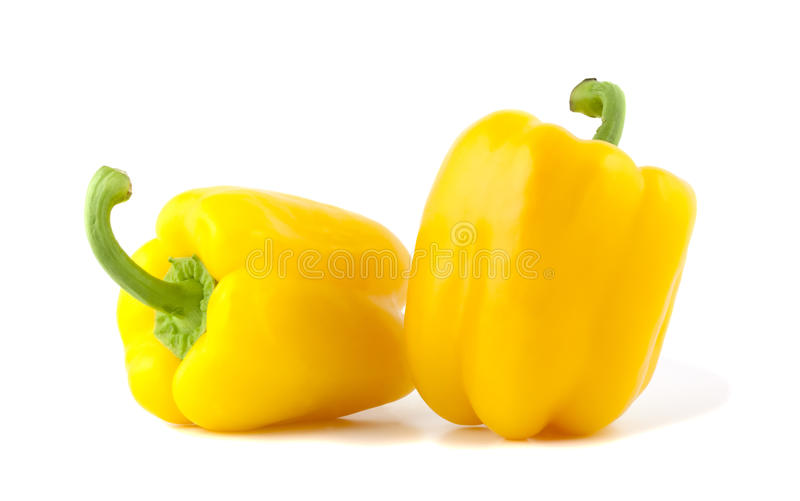 Yellow bell peppers isolated on white background. stock photos