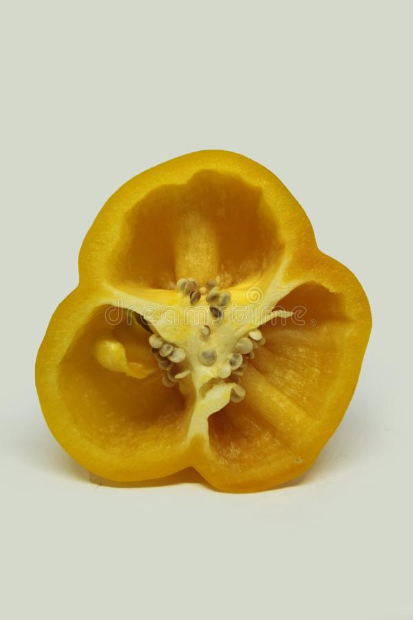 Yellow bell peppers on white background stock images