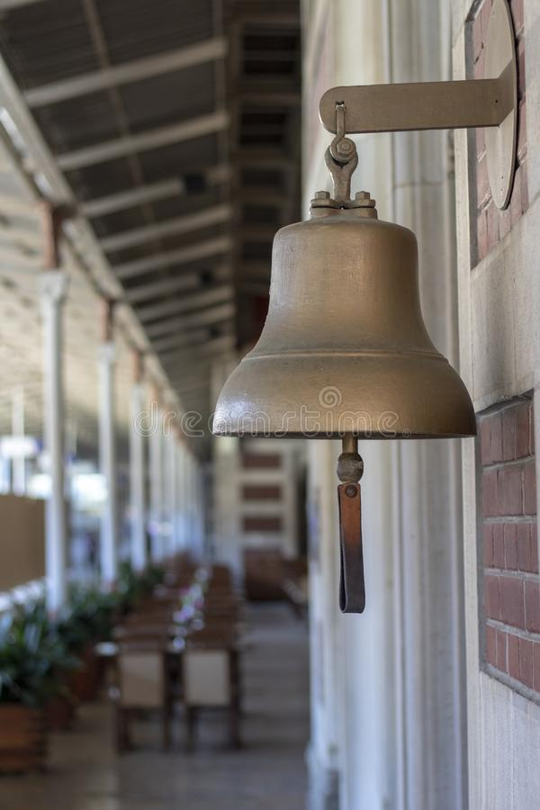 Yellow bell at the railway station. Old history. Taken from the side stock photos