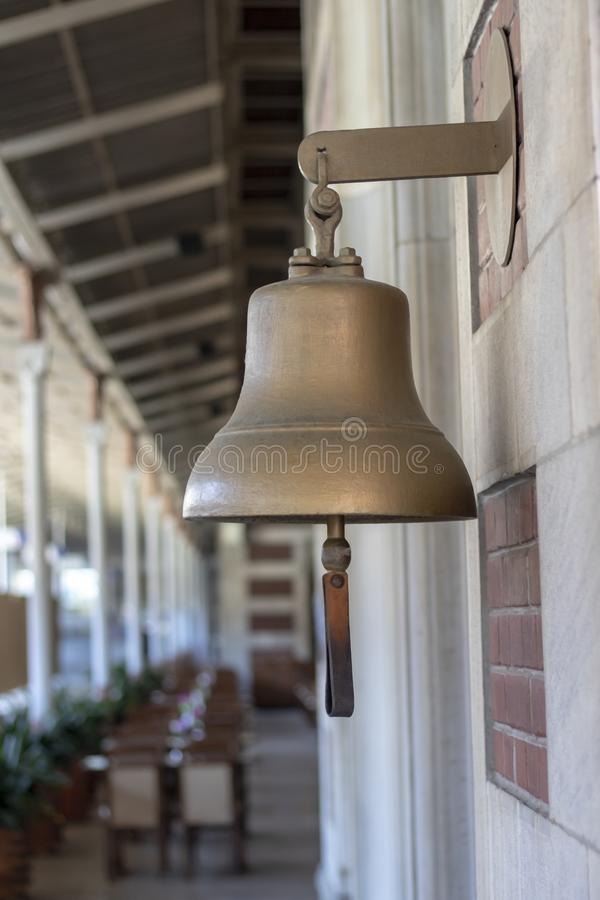 Yellow bell at the railway station. Old history. Taken from the side. Travel, decoration, metal, design, brass, ring, traditional, antique, vintage, train royalty free stock photos