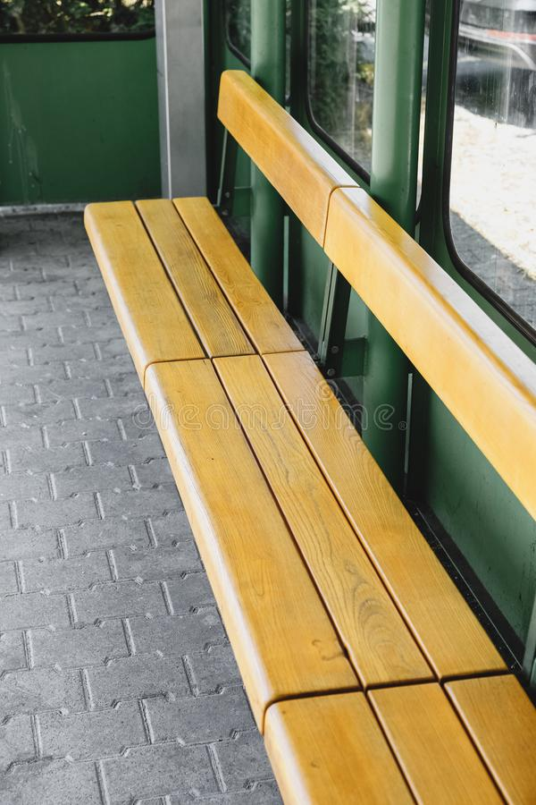 The yellow bench at the bus stop. Chair in bus stop. bench at the bus stop stock photo