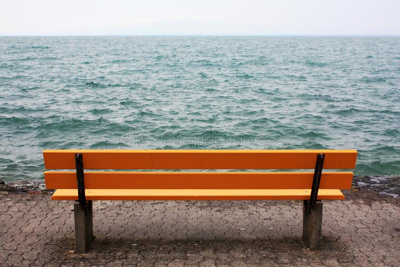 Yellow bench on the lake in Switzerland. stock image
