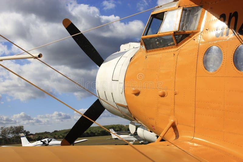 Yellow Bi-Plane stock images