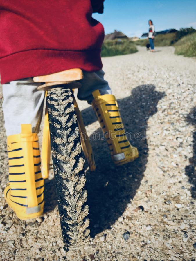 Yellow Bicycle on Brown Sand royalty free stock image