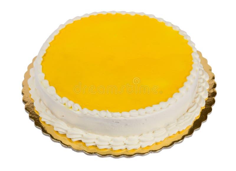Yellow birthday cake. Isolated on white background stock photography