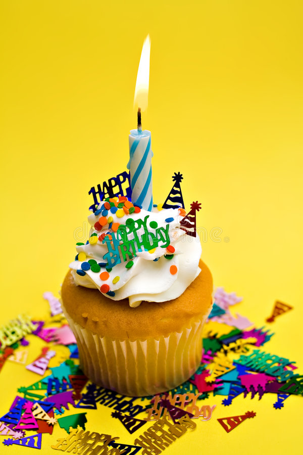 Yellow Birthday Cupcake royalty free stock images