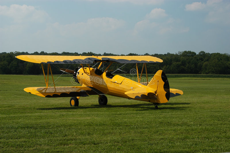 Yellow & Black Biplane stock photos