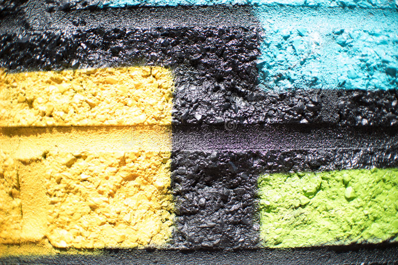 Yellow Black Blue Green Brick Wall Background. Painting royalty free stock images