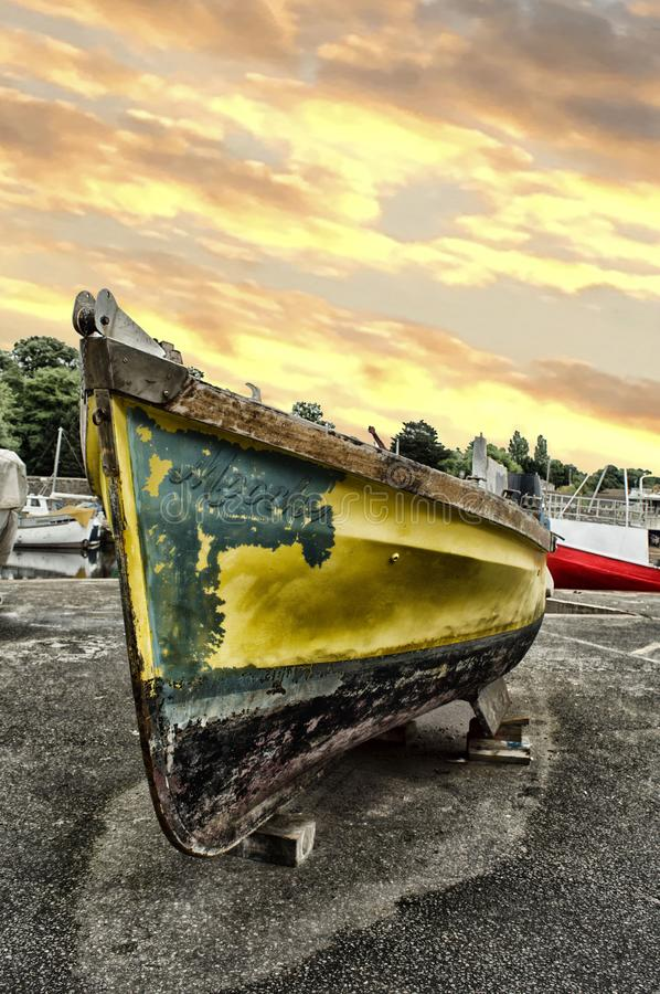 Yellow and Black Boat stock photo
