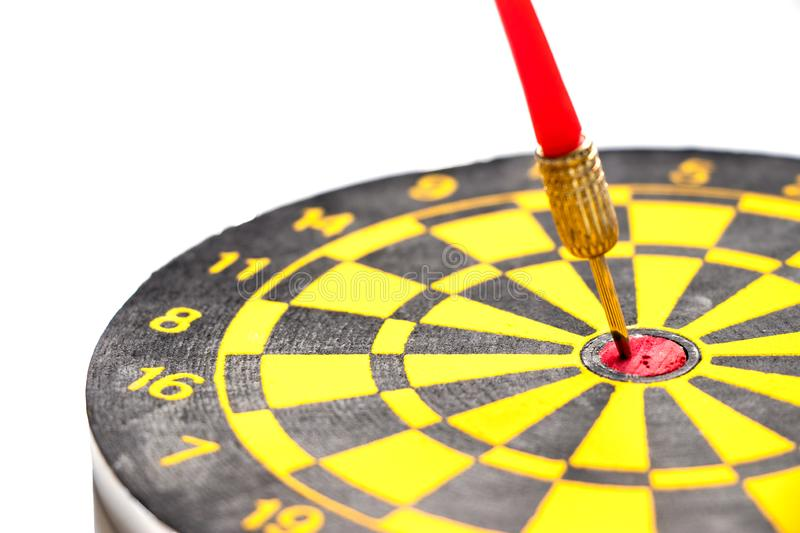 Yellow and black color dartboard with number and have the dart hit at red dot on white background & x28;Concept for business focus stock photography