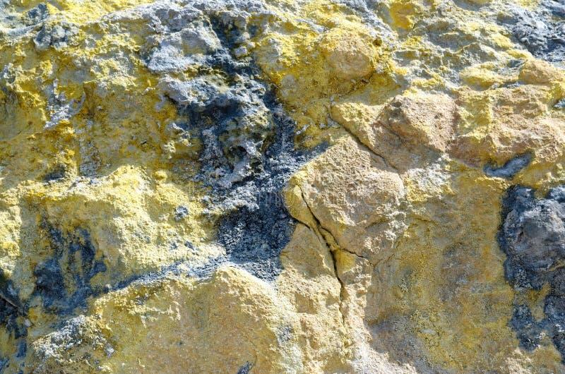 Sulfur texture, island Vulcano, Lipari, Italy. Yellow and black colored Sulfur texture as a background. Island Vulcano, Lipari, italy stock images