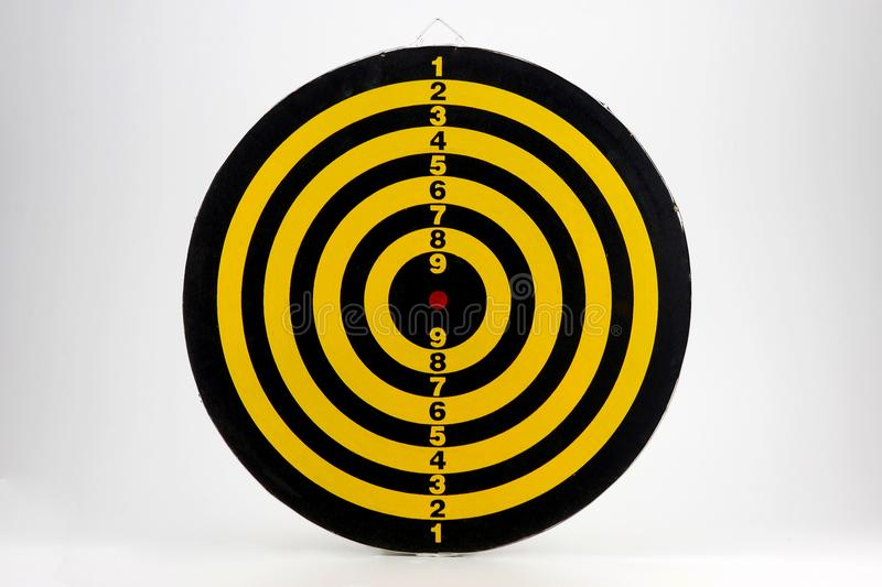 Beatiful dartboard isolated on white background. Yellow and black dartboard picture stock photo