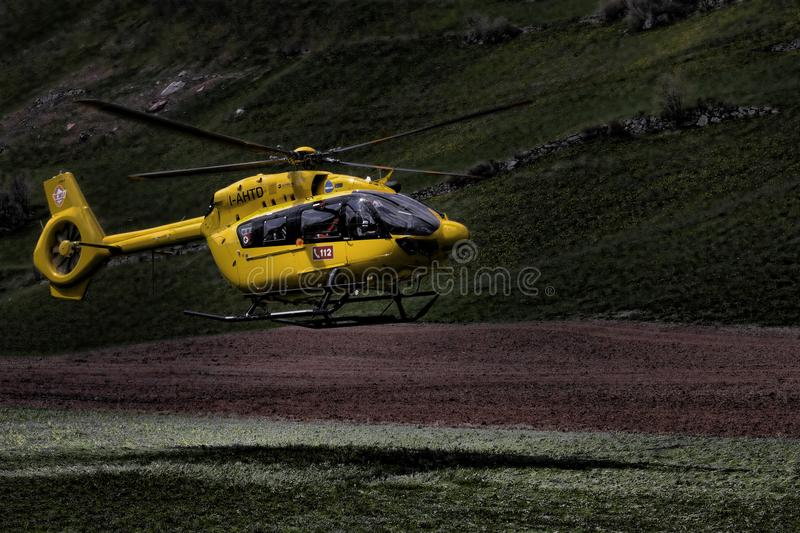 Yellow and Black Helicopter stock photos