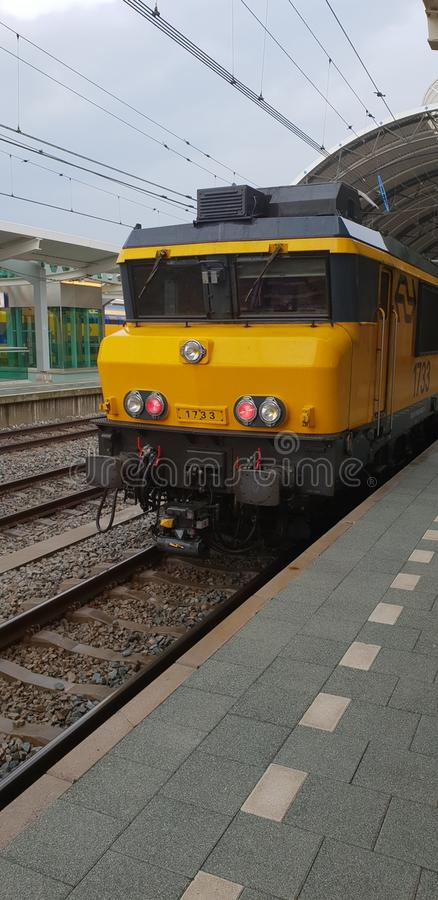 Locomotive of the dutch railways waiting along platform on Zwolle central station stock photos