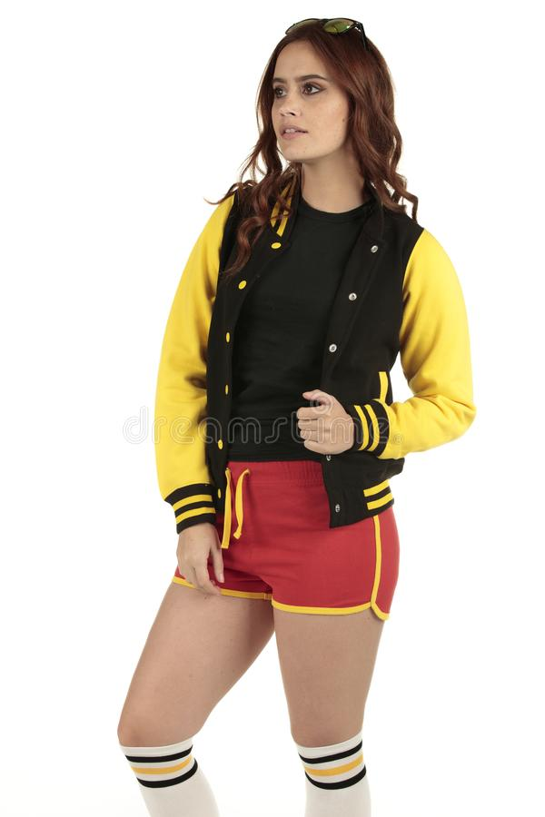 Yellow black and red colored retro sports wear with an empty space on the black shirt for you to add your brand royalty free stock images