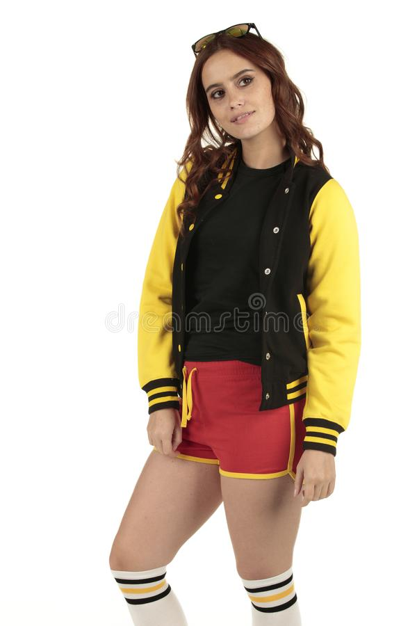 Yellow black and red colored retro sports wear with an empty space on the black shirt for you to add your brand stock photo