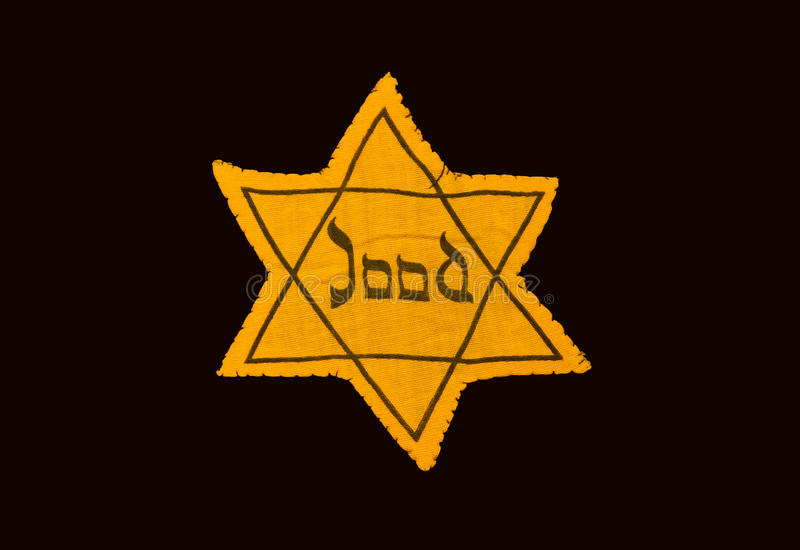 Yellow and black star which the Jews were required to wear in occupied Holland during World War 2. Dutch language royalty free stock image