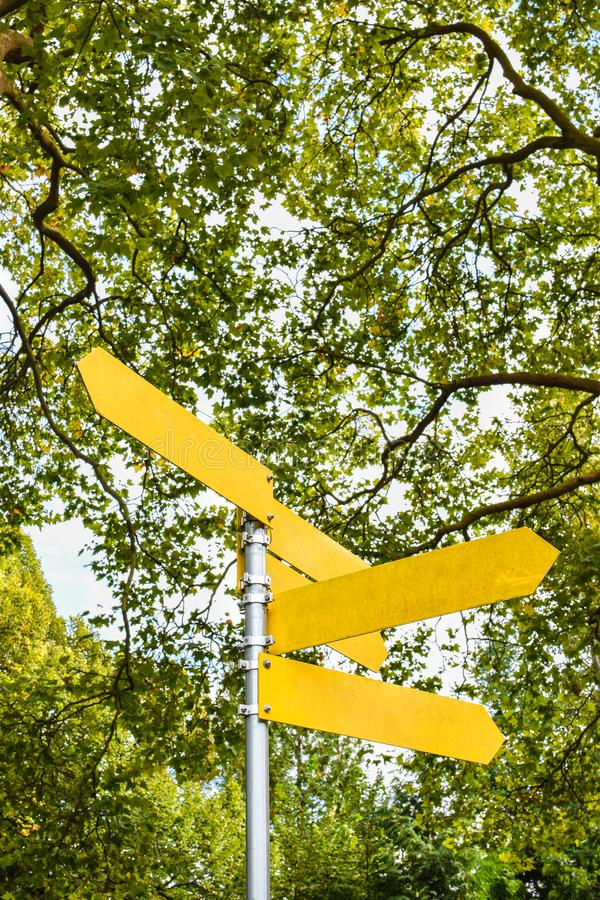 Yellow blank directional arrows on signpost. stock images