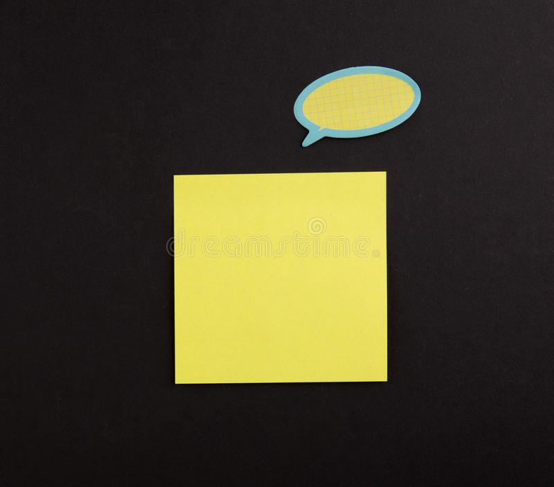 Yellow Blank Sticky Note on black background royalty free stock photos