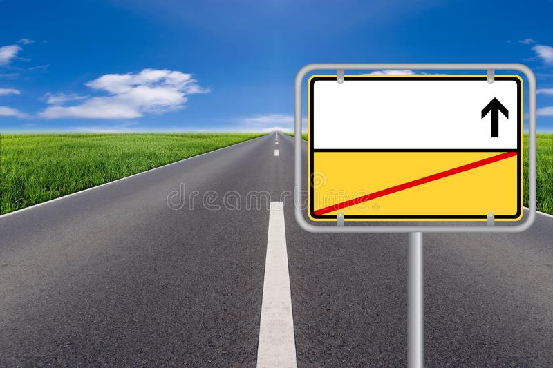 Yellow blank Street Sign with street in background. royalty free stock photo