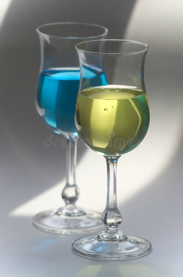 Yellow and blue drinks in glasses stock photo