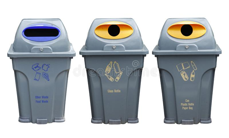 Yellow, blue and gray recycle bins with recycle symbol on white background. Yellow, blue and gray recycle bins with recycle symbol isolated on white background stock photography