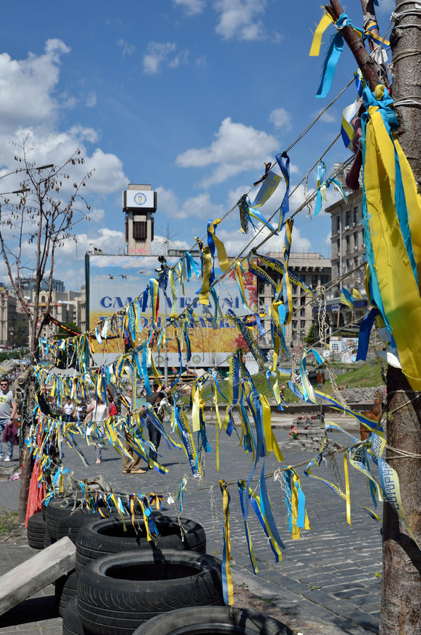Yellow and blue Maidan in the Ukrainian capital. There are many national ribbons, tyres and a large banner in the Independence Square of Kyiv stock image