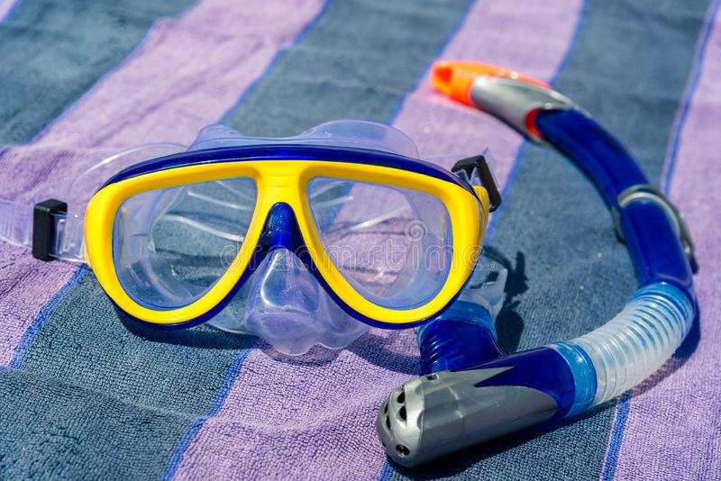 Yellow-blue mask and snorkel for the whole frame. Horizontal frame stock photos