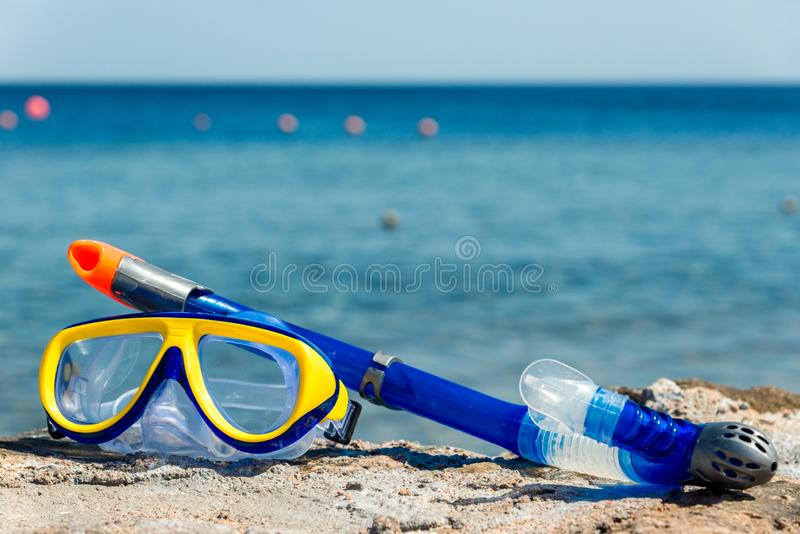 Yellow-blue mask and snorkel for the whole frame. Horizontal frame stock images