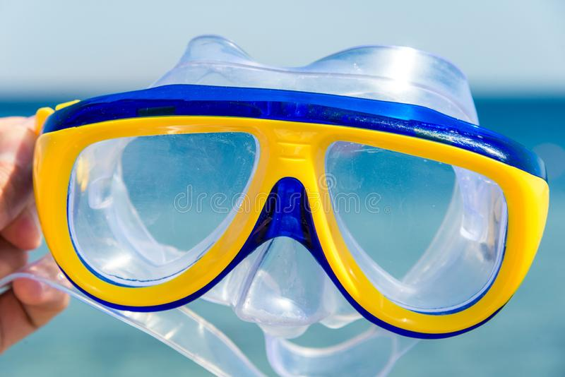 Yellow-blue mask and snorkel for the whole frame. Horizontal frame royalty free stock image