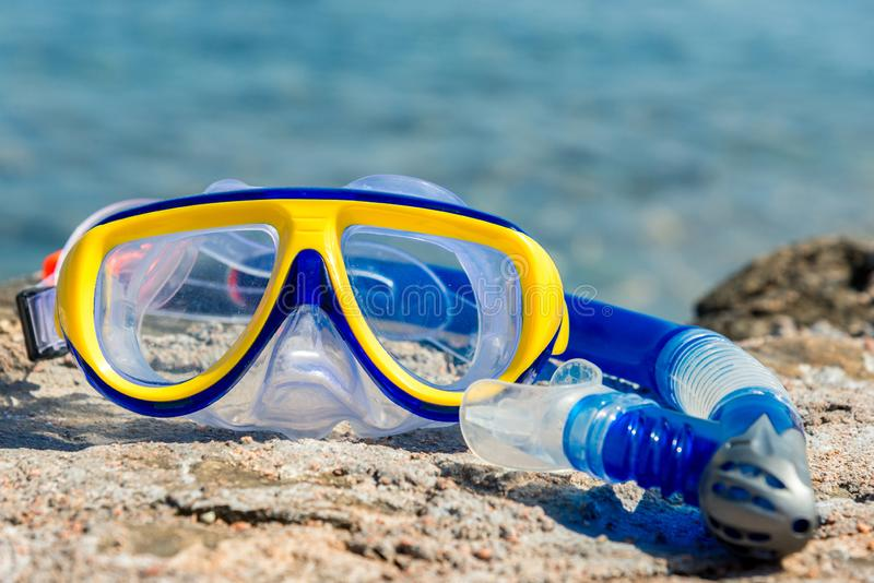Yellow-blue mask and snorkel for the whole frame. Horizontal frame royalty free stock photo