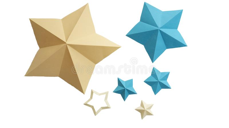 Yellow and blue paper stars isolated on white background. Origami stars.  royalty free stock photo