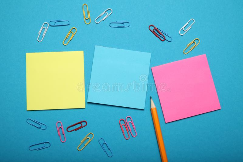 Yellow blue and pink paper note, piece blank. Empty sheet, letter.  royalty free stock photos