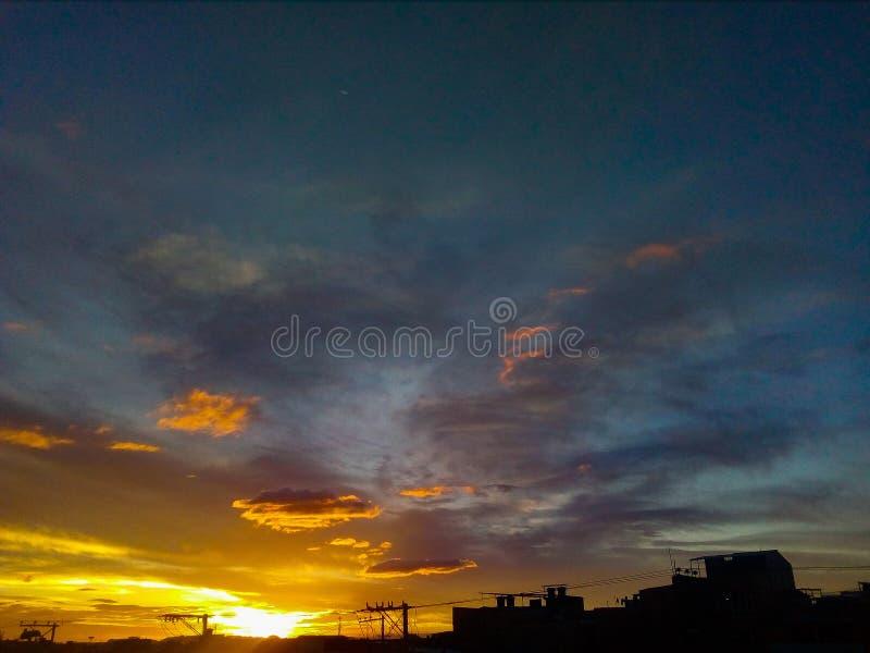 Yellow and blue sky stock photos